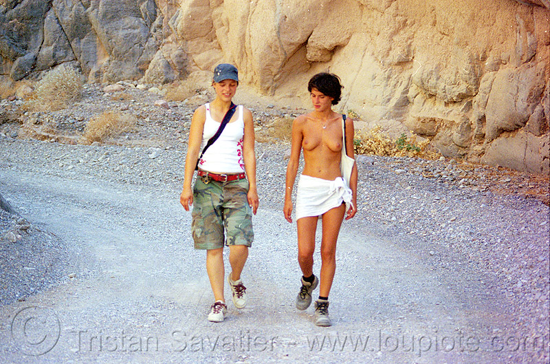 anke and alex hiking in death valley, anke rega, breasts, burning man, death valley, dirt road, fall canyon, hiking, neon, the man, topless woman, unpaved, women
