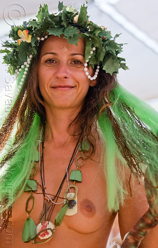 biblical eve, breasts, burning man, center camp, crown, eve, green wig, headdress, headwear, leaves, maude, necklaces, topless woman