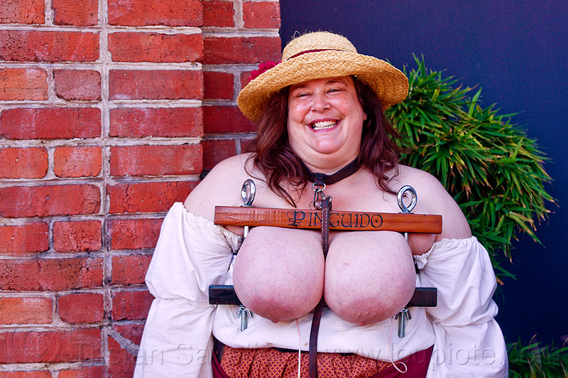 busty woman with breast clamps - folsom street fair, big, breast clamps, fat, huge, large, oversize, pinguido, press, squeeze, squeezed, straw hat, topless, woman