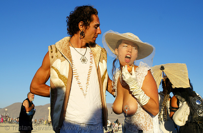 couple at the silent white procession - burning man 2007, breasts, burning man, couple, dawn, hat, silent white procession, sun rise, topless woman, veil, white morning
