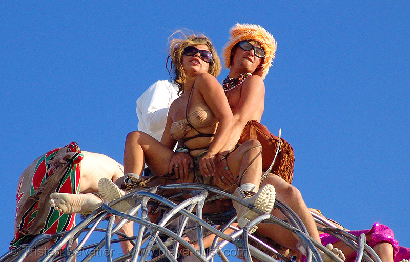 couple at the top of I.T., the giant three-legged alien sculpture - burning-man 2006, art, breasts, burning man, michael christian, three-legged alien, topless woman
