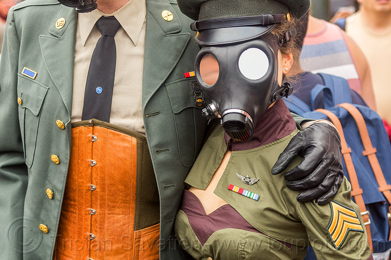 couple in military fetish uniform costumes, army, bondage, corset, costumes, couple, fetish, folsom street fair, gas mask, leather glove, man, masked, military, soldiers, uniform, woman