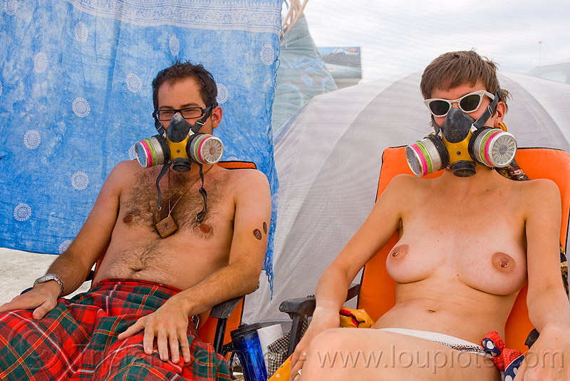 couple wearing dust masks - sara and callum - burning man 2009, 3m respirator, burning man, callum, couple, dust mask, respirator cartridges, sara, sunglasses, topless woman