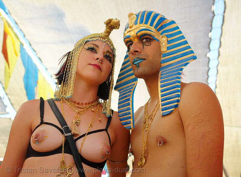 egyptian couple - burning-man 2006, art, body jewelry, breasts, burning man, center camp, couple, nipple piercing, topless woman