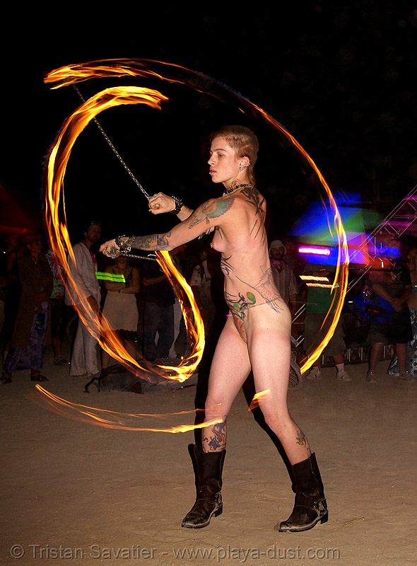 spinning fire poi - tattoos - woman - burning man 2007, burning man, fire dancer, fire dancing, fire performer, fire poi, fire spinning, flames, long exposure, naked, night, nude, spinning fire, tattooed, tattoos, topless woman