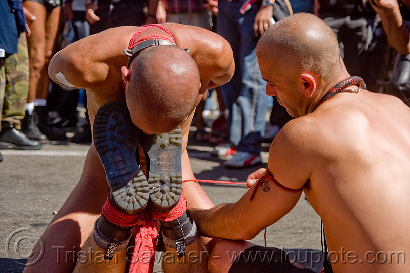 tony buff performing rope bondage - dore alley fair (san francisco), back piece, boots, dore alley fair, fetish, knots, men, red rope, rope bondage, soles, tony buff