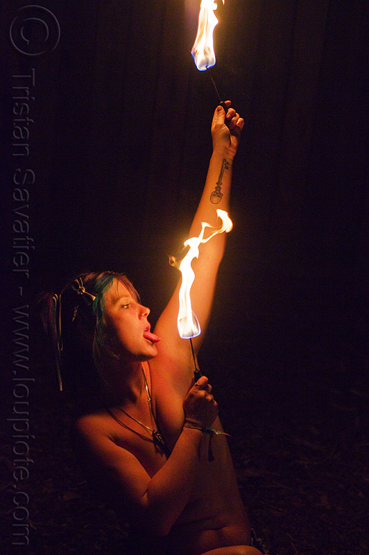 topless fire dancer, arm tattoo, fire dancer, fire dancing, fire performer, fire spinning, fire wicks, flames, haley, necklaces, night, tattooed, tattoos, tongue, topless woman