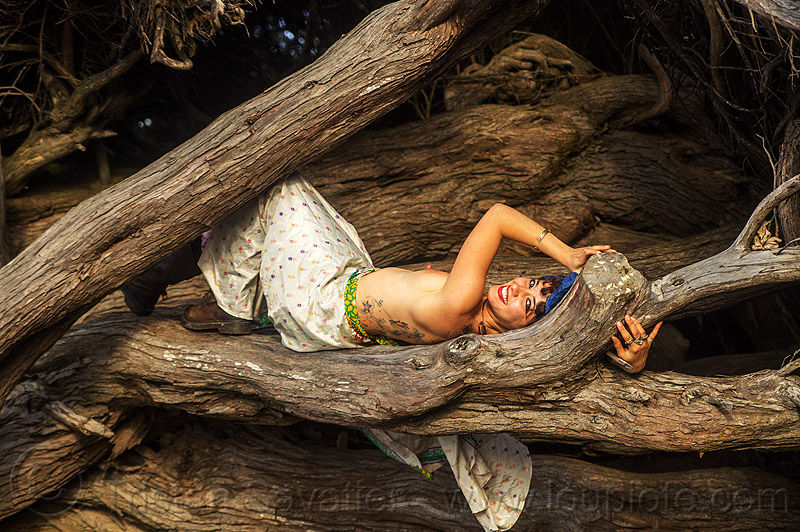 topless woman lying down on tree log, back tattoos, breasts, juniper, lying down, topless woman, tree log, trunk, white dress