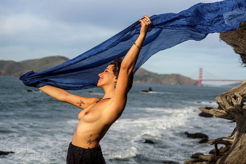 topless woman with blue scarf in the wind on ocean coast, blue scarf, fashion, golden gate bridge, seashore, suspension bridge, tattoos, topless, wind, windy, woman