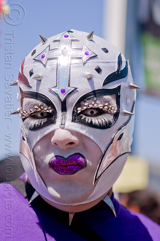 white mask with spikes, color contact lenses, color contacts, cross, feather eyelashes extensions, gay pride festival, makeup, man, mask, purple lipstick, white contact lenses, white contacts