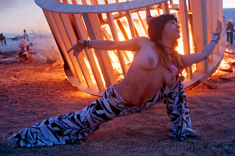 woman dancing near fire, burning man, dancing, dusk, fire, frame, heather, stretching, topless, woman, wood, wooden