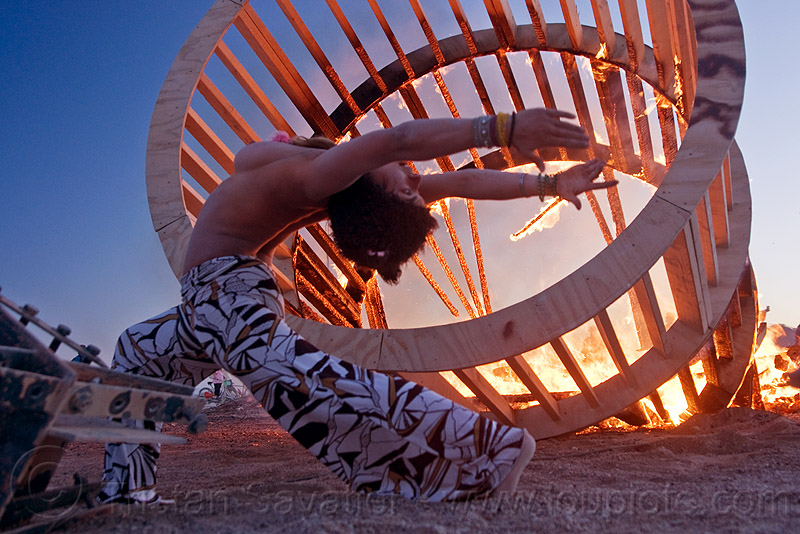 woman stretching near fire, burning man, cylinder, cylindrical, dancing, dusk, fire, frame, heather, stretching, topless, woman, wood, wooden