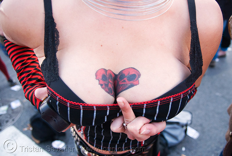 breasts tattoo, breast tattoo, breasts tattoo, cleavage, finger, how weird festival, melody, skull tattoo, tattooed, tattoos, woman