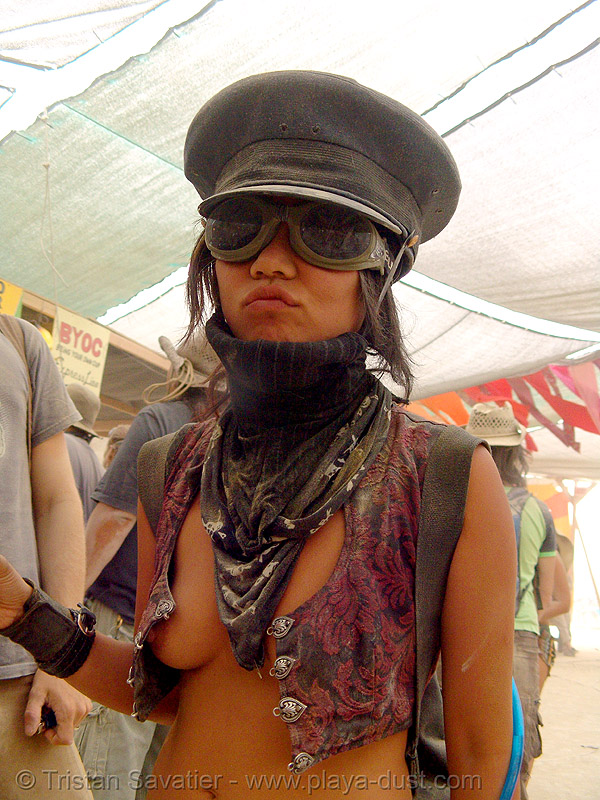 """woman with goggles and army cap - nej """"tank girl"""" - burning man 2007, breasts, burning man, center camp, dust storm, goggles, military cap, military hat, nej, tank girl, topless woman"""