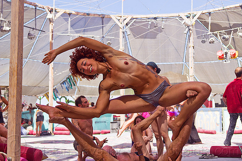 acro-yoga - burning man 2012, acro yoga, ahni radvany, burning man, center camp, topless woman