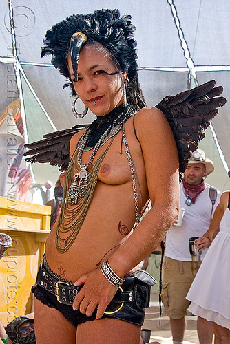 black angel, angel wings, black angel, black feathers, burning man, center camp, chain necklace, costume, dark angel, delfine, headdress, headwear, horn, metal necklace, necklaces, topless woman