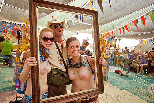 blain with two girls in frame - burning man 2013, blain, burning man, center camp, empty frame, hat, sunglasses, topless woman, women