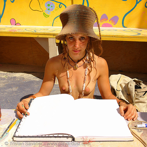 blank book - paper hat - tiggrr and - burning-man 2006, blank book, blank pages, burning man, tiggrr, topless, woman
