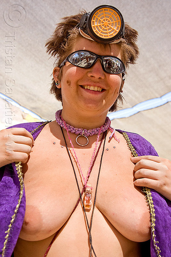 braided rope necklace, breasts, burning man, center camp, clavicle piercing, dust mask, necklaces, nikola, respirator, sila, sunglasses, surface piercing, topless woman