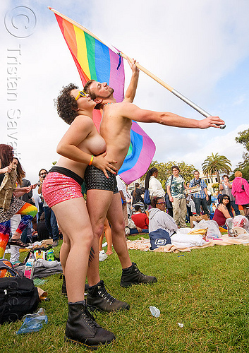 couple dancing with rainbow flag, couple, dancing, dolores park, flag pole, gay pride festival, man, rainbow flag, topless woman