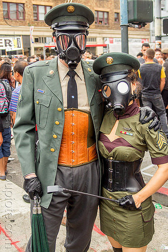 couple in military uniform fetish costume - gas masks, army, bondage, corset, costumes, fetish, gas masks, leather gloves, man, mask, masked, military cap, military hat, soldiers, uniform, whips, woman
