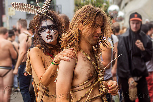 couple in tribal fetish costume - rope bondage, body paint, body painting, bones, costume, couple, feathers, fetish, folsom street fair, makeup, man, necklace, rope bondage, tribal, woman