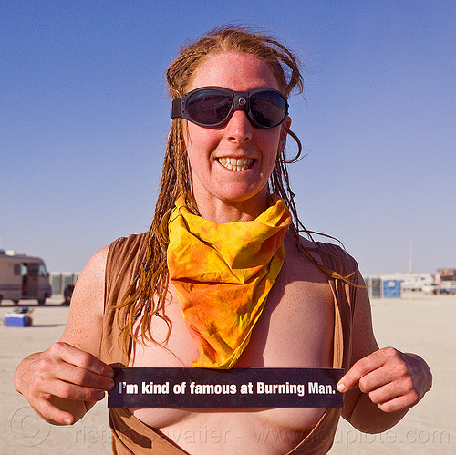 famous burner - burning man 2012, bandana, braid, braided hair, bumper sticker, burning man, famous burner, goggles, topless woman, yellow bandanna