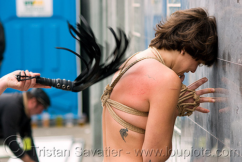 flagellation - flogging - girl being whipped, bondage rope, bondage whip, dore alley fair, fetish, flagellation, flogging, muscle beach, rope bondage, whipped, woman