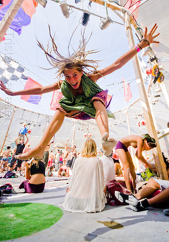 girl jumping in center camp - burning man 2012, blonde, burning man, center camp, dreads, jump, jumpshot, topless woman