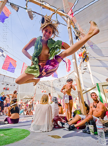 karate kid in center camp - burning man 2012, blonde, burning man, center camp, dreadlocks, dreads, jump, jumpshot, karate, kick, kicking, topless woman