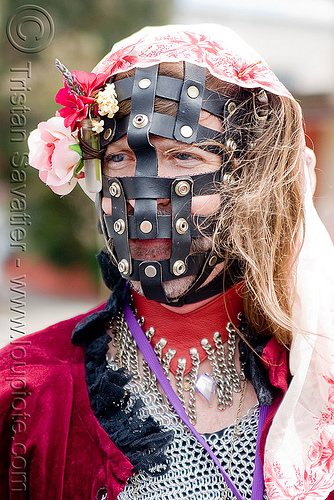 leather bondage muzzle, bondage, chainmail, drag, flowers, leather, man, muzzle, sisters of perpetual indulgence