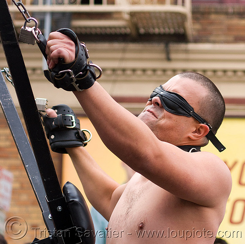 man strapped to st andrews cross - dore alley fair (san francisco), bondage mask, crux decussata, dore alley fair, fetish mask, leather, man, saint andrew's cross, saltire cross, st andrew, st. andrew's cross, straps
