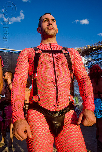 man wearing pink fishnet and leather - burning man 2009, costume, fishnet bodysuit, leather underwear, man, pink, rings, straps