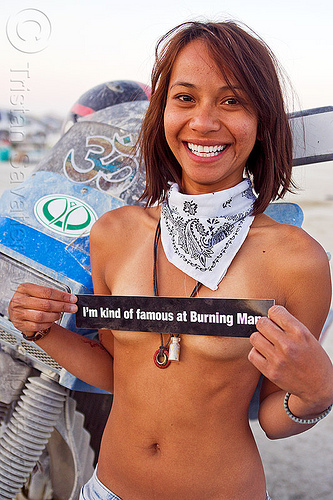 my very charming neighbor is famous - burning man 2012, bandana, bumper sticker, burning man, famous burner, klr 650, motorcycle, topless, white bandanna, woman