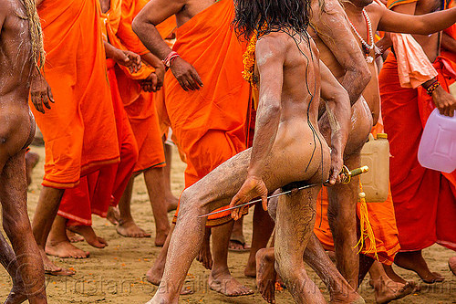 naga sadhu wrapping penis around sword - kumbh mela 2013 (india), bhagwa, hindu pilgrimage, hinduism, india, maha kumbh mela, saffron color