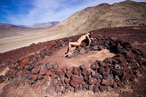 nude woman on heart of stone, basalt, death valley, desert, heart, igneous rocks, mountains, naked, nude, saline valley, stones, sunbathing, topless woman, volcanic rocks, volcano