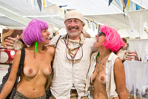 philippe glade with twin sisters - burning man 2013, bek, breasts, burning man, center camp, identical twins, philippe glade, pink wig, purple wig, tiche, topless woman, twin sisters, wigs, women
