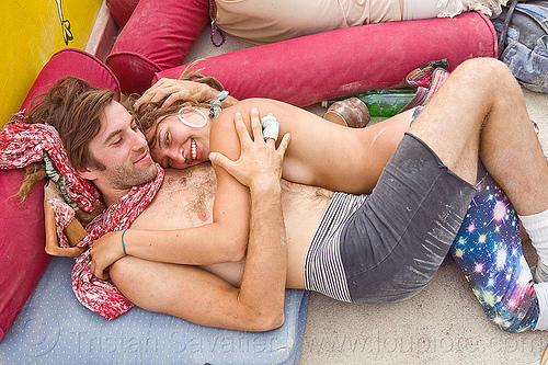 post burn bliss - burning man 2013, burning man, center camp, couple, embracing, hugging, lovers, lying down, pillows, resting, topless woman