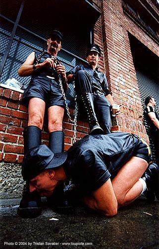 16700 - power play - boot licking - folsom street fair (san francisco), black, bondage, boots, costumes, fetish, folsom street fair, leather jackets, leather pants, leather uniforms, licking, men