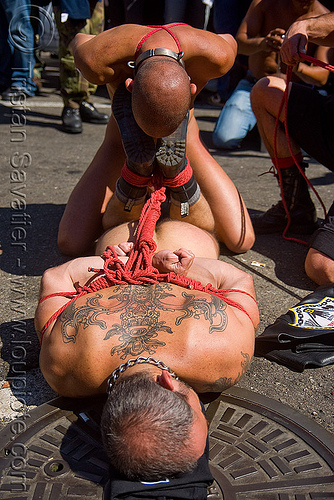 rope bondage - derek da silva tied-up by tony buff - dore alley fair (san francisco), back piece, derek da silva, dore alley fair, fetish, knots, man, red rope, rope bondage, tattooed, tattoos, tony buff