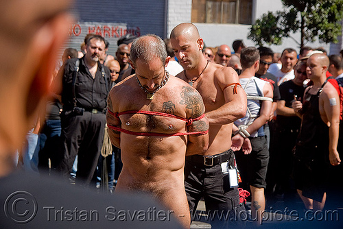 rope bondage - tony buff tying-up derek da silva - dore alley fair (san francisco), derek da silva, dore alley fair, fetish, knots, men, red rope, rope bondage, tattooed, tattoos, tony buff