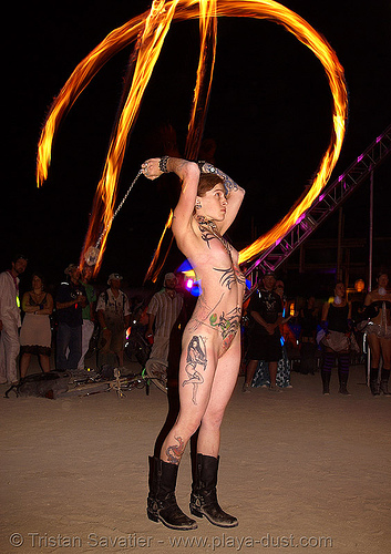 spinning fire poi - tattoos - girl - burning man 2007, burning man, fire dancer, fire dancing, fire performer, fire poi, fire spinning, flames, long exposure, naked, night, nude, spinning fire, tattooed, tattoos, topless woman