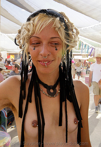 teresa in center camp - burning man 2007, body jewelry, burning man, center camp, nipple piercing, nose piercing, nostril piercing, septum piercing, teresa, topless woman