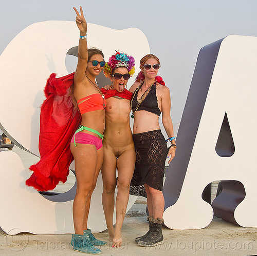 three girls at INSANITY - burning man 2013, art installation, burning man, insanity, letters, nude, sunglasses, topless, women