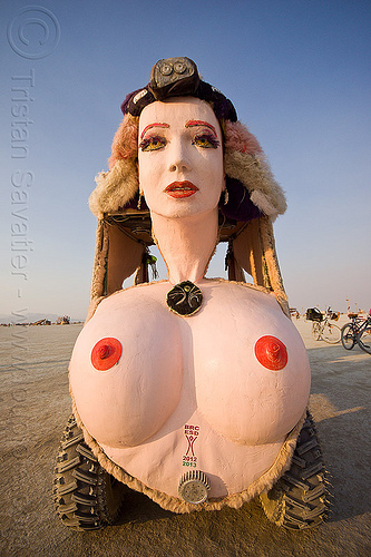 topless woman art car - burning man 2013, burning man, head lamp, head light, mutant vehicles, necklace, nipples, petzl, topless, unidentified art car, woman