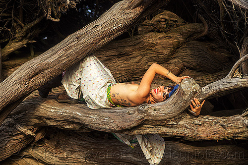 topless woman lying down on tree log, back tattoos, juniper, lying down, topless, tree log, trunk, white dress, woman