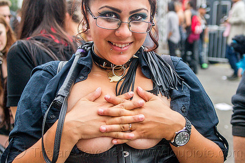 topless woman trying to hide breasts, emma, folsom street fair, lip piercing, prescription glasses, spectacles, underboops, whip, woman
