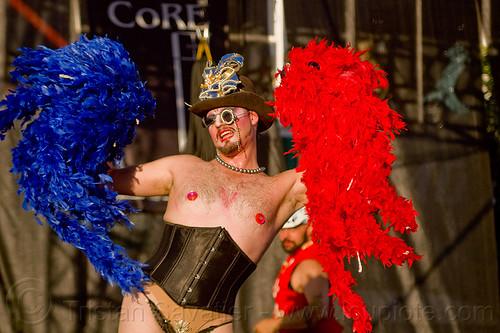 trans man in vaudeville cabaret show - folsom street fair (san francisco), cabaret, corset, feathers, hat, man, monocle, performer, show, trans, transgender, transsexual, vaudeville