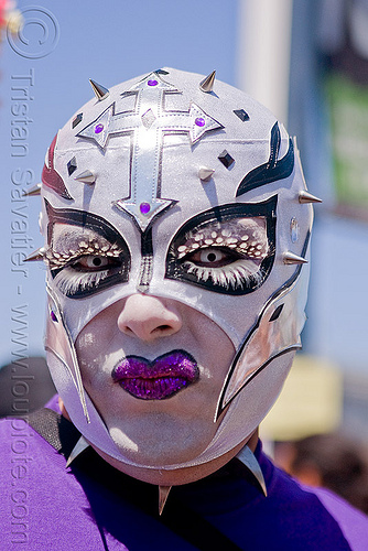 white mask with spikes, color contact lenses, color contacts, cross, feather eyelashes extensions, gay pride festival, makeup, man, mask, purple lipstick, spikes, white contact lenses, white contacts