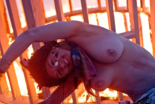 woman dancing near fire, burning man, dancing, dusk, fire, flames, frame, heather, stretching, topless woman, wood, wooden